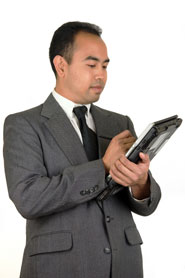Male manager using tablet computer