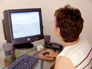 Woman using wireless desktop computer at home