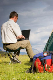 Man accessing Web from campsite